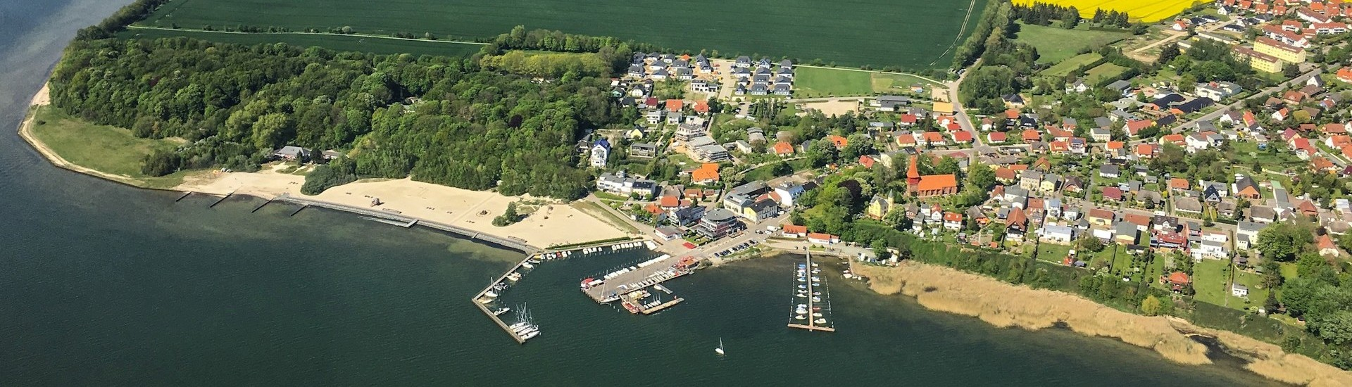 Altefaehr from the air with a view on the holiday home park 'Sonnengarten - Sunny Garden'.