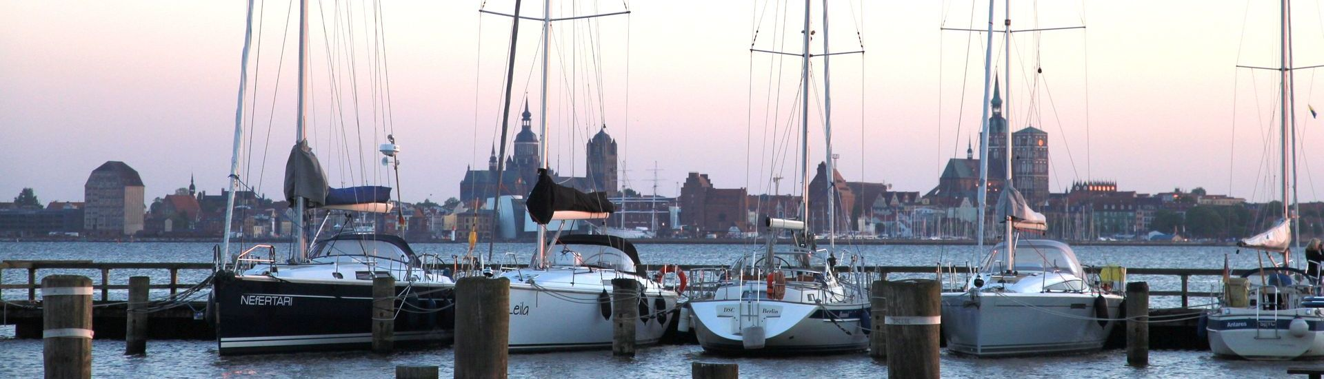 The harbour of Altefaehr with view to the skyline of Stralsund.